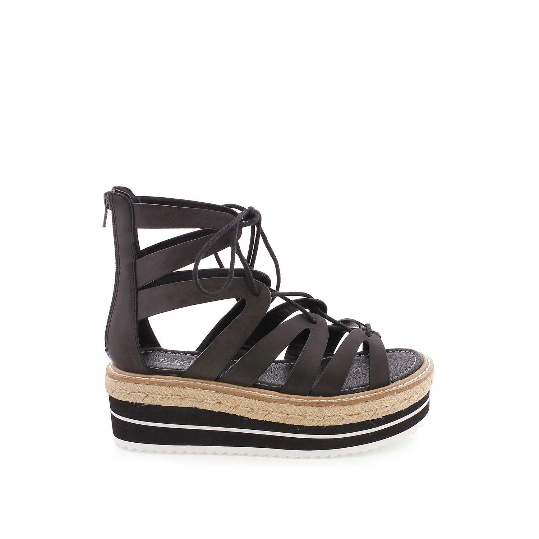 Sandalia estilo griega con cuerdas para atartela a la pierna y plataforma<br />