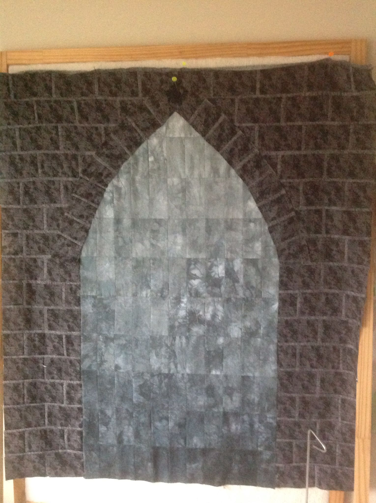 Step 2 Colour wash using tear away and hand dyed grey fabric, machine pieced bricks and mortar
