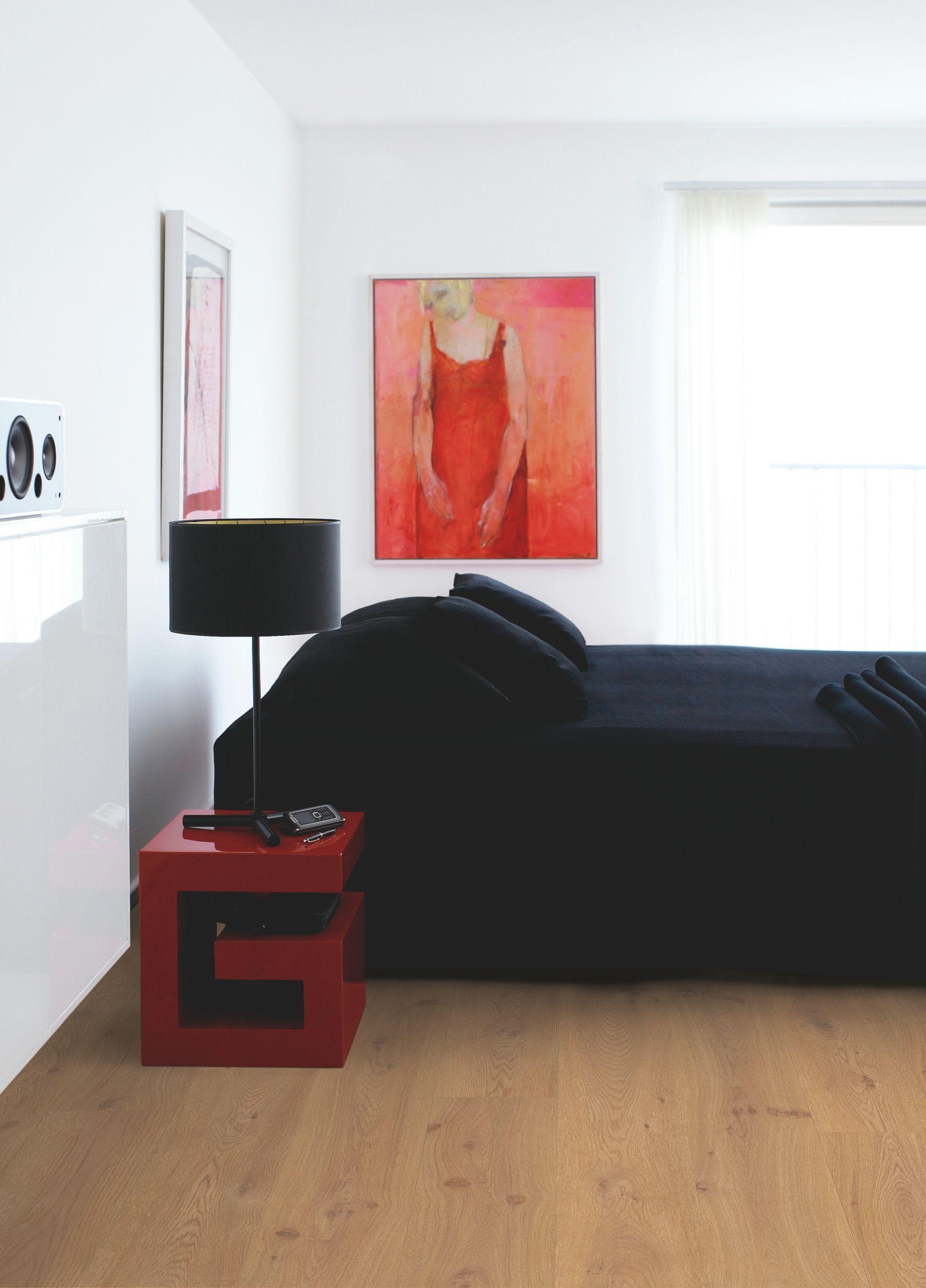 Photo of Pergo Laminate Flooring – Long Plank 'European Oak, Plank' (L0323-01756). In a modern …