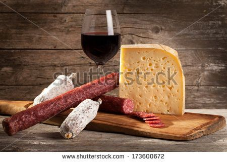 Italian cheese and salami with glass of red wine. by eZeePics Studio, via Shutterstock
