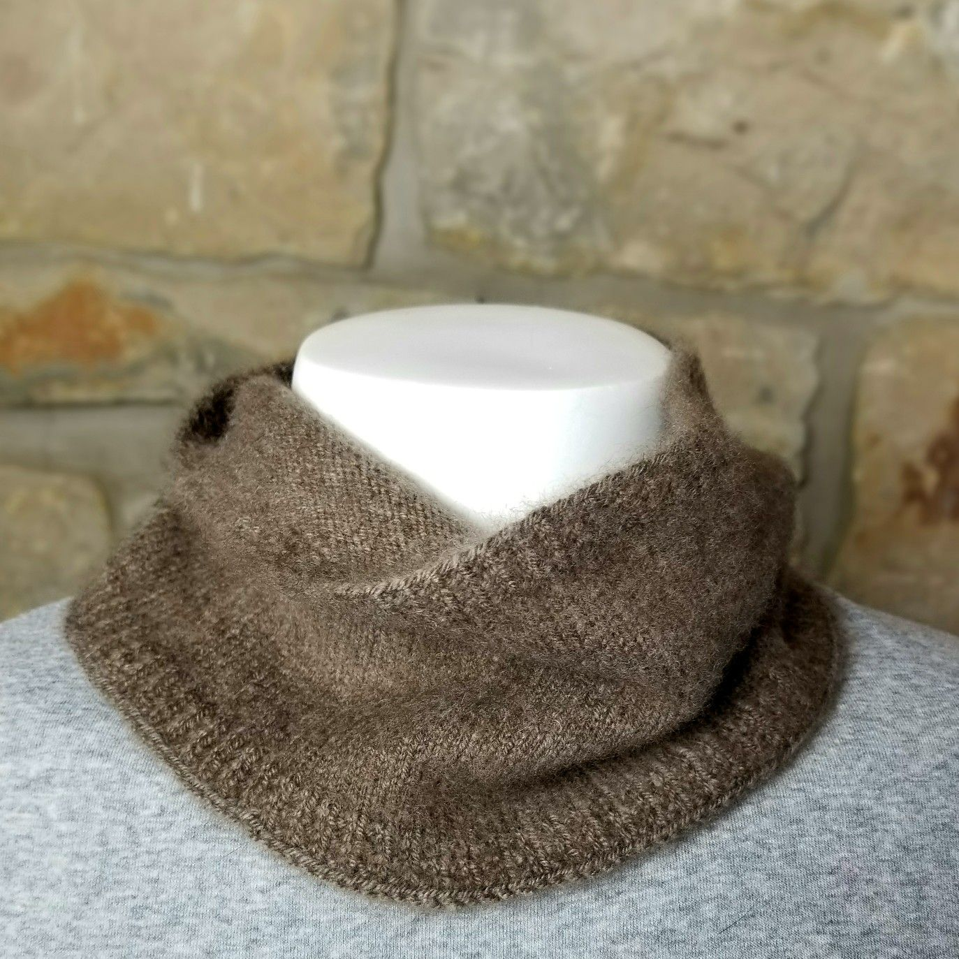 Qiviut (musk ox) cowl. This is a shorty which is perfect for covering just the neck up to the chin AND keeping the price down. It still has a larger rib at the bottom for covering or tucking into the neck band. For those that are unfamiliar with the fiber, it's 8 times warmer than wool, softer than cashmere and light as a feather...oh, and extremely durable. From what I've heard, it's not all that easy to harvest either. All those things combined make for a pricey but solo worth it!