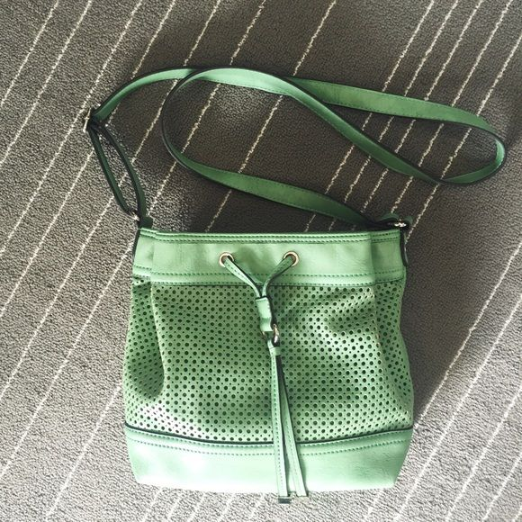 """Franco Sarto Mint Green Crossbody Bag Mint green leather crossbody bag from Franco Sarto. Drawstring detail in front, lots of space and pockets. Measurements are about 8""""x6""""x4"""". Bought at a sample size, tag still attached. Franco Sarto Bags Crossbody Bags"""