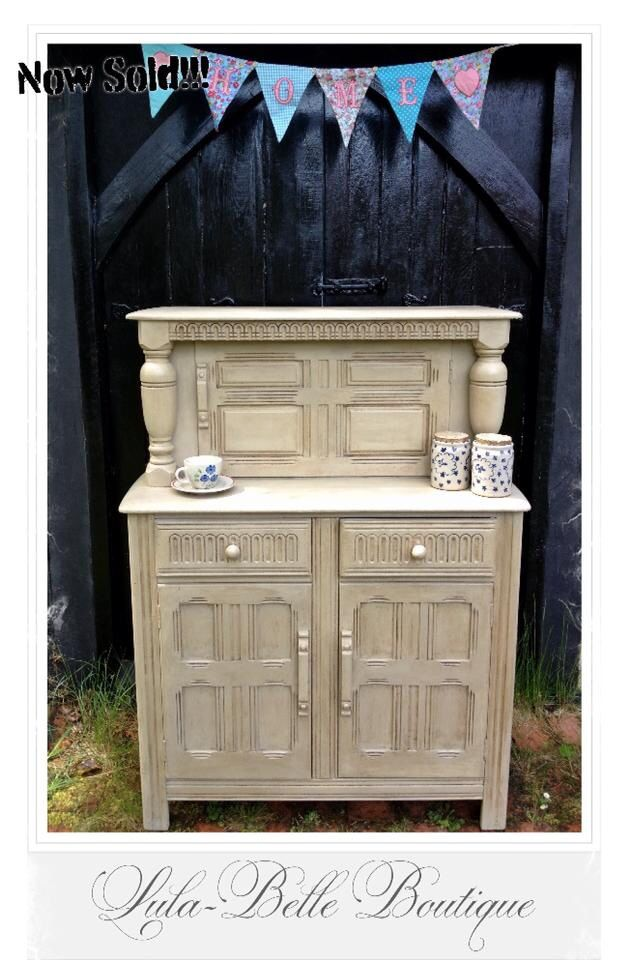 Buffet sideboard painted in country grey chalk paint with the use of clear and dark wax for an