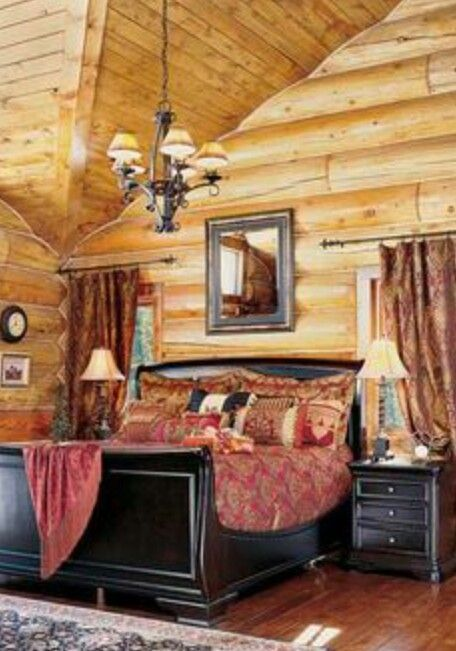 Love the high ceiling and the light color of the logs in this cabin