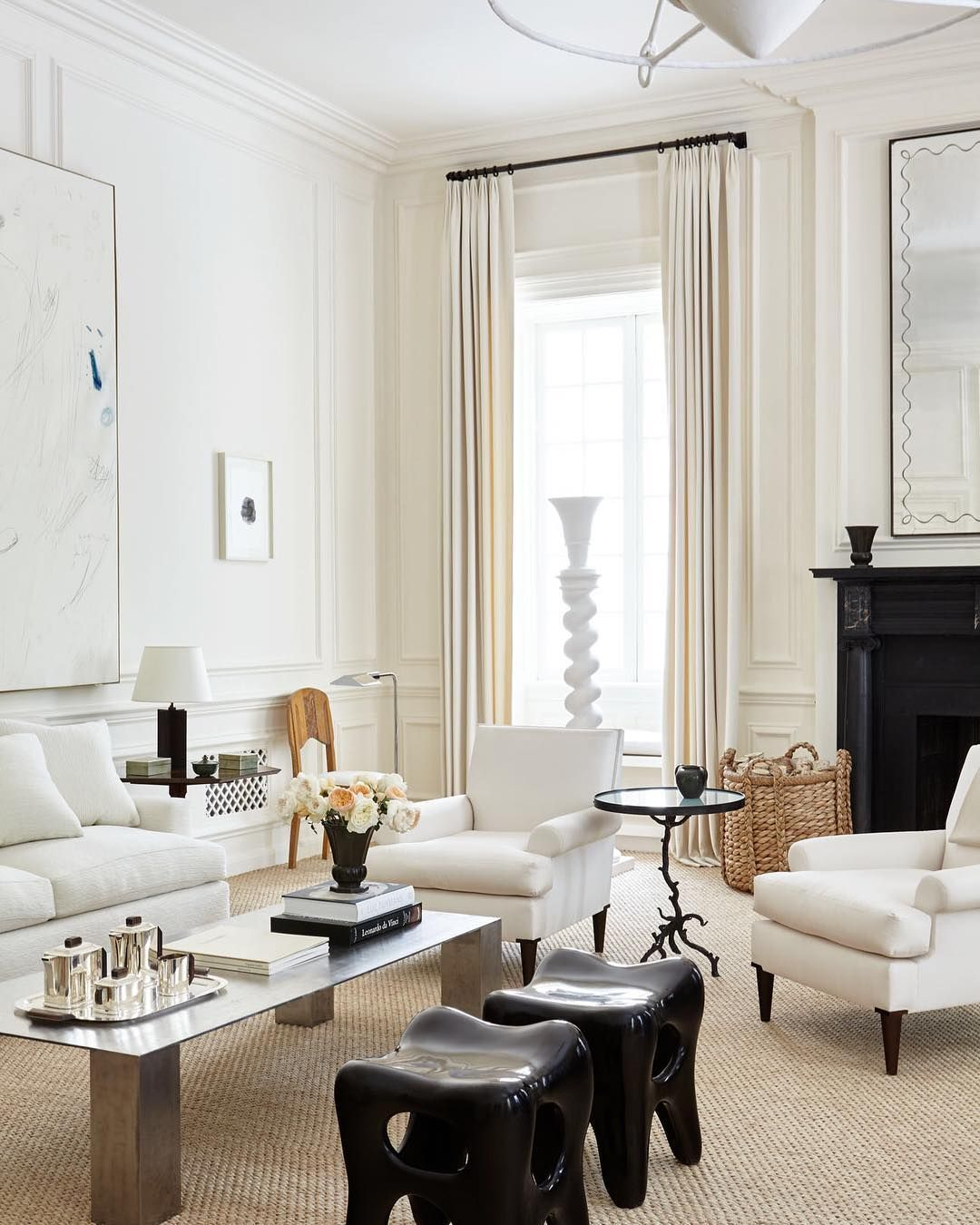 A neutral living room with a sisal rug and modern accents interior