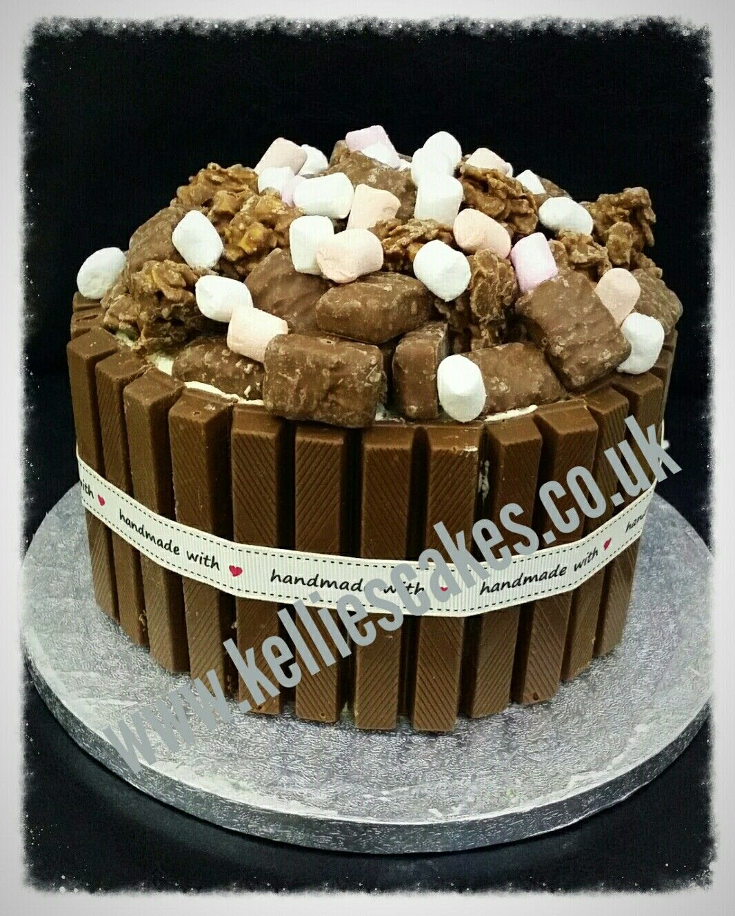 Chocoholics delight - chocolate cake topped with different bars and marshmallows