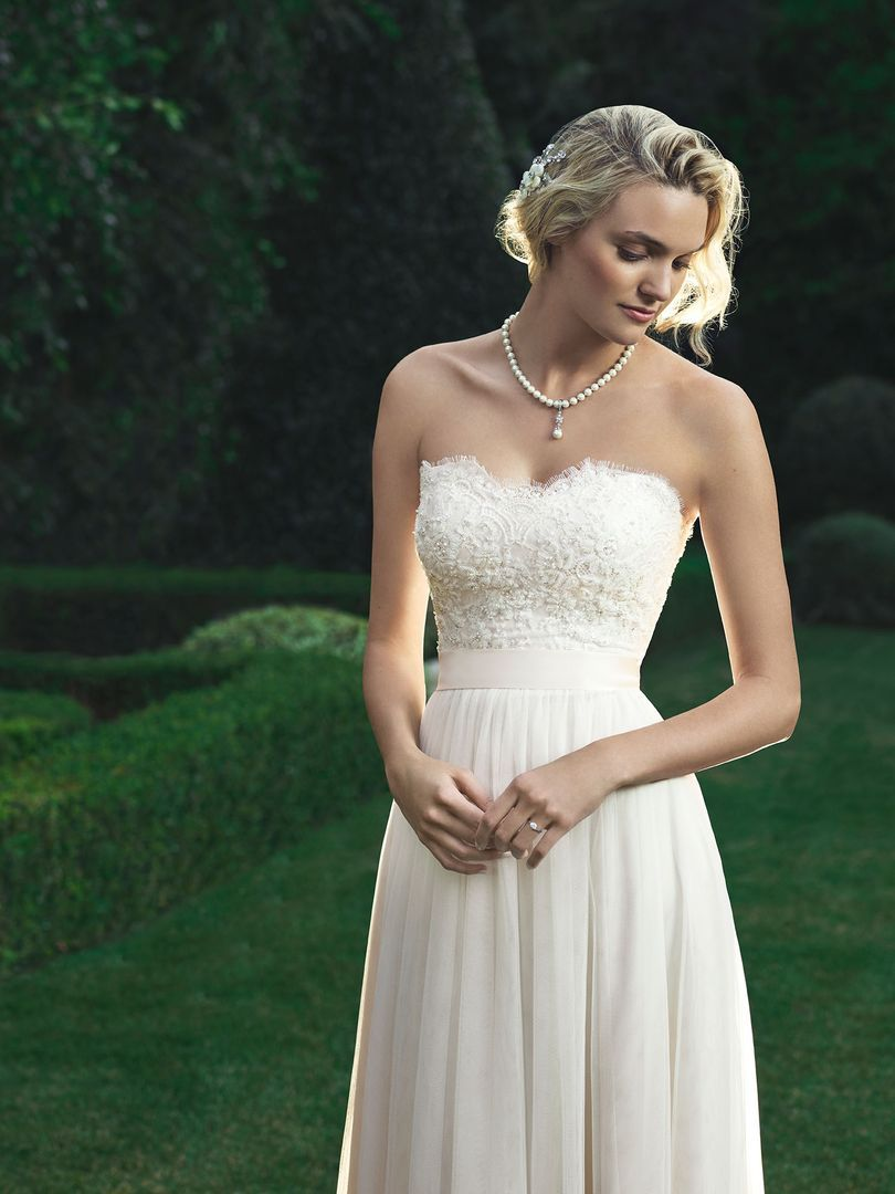 Baby doll silhouette shaped gown made of a Soft Tulle with a beaded ...