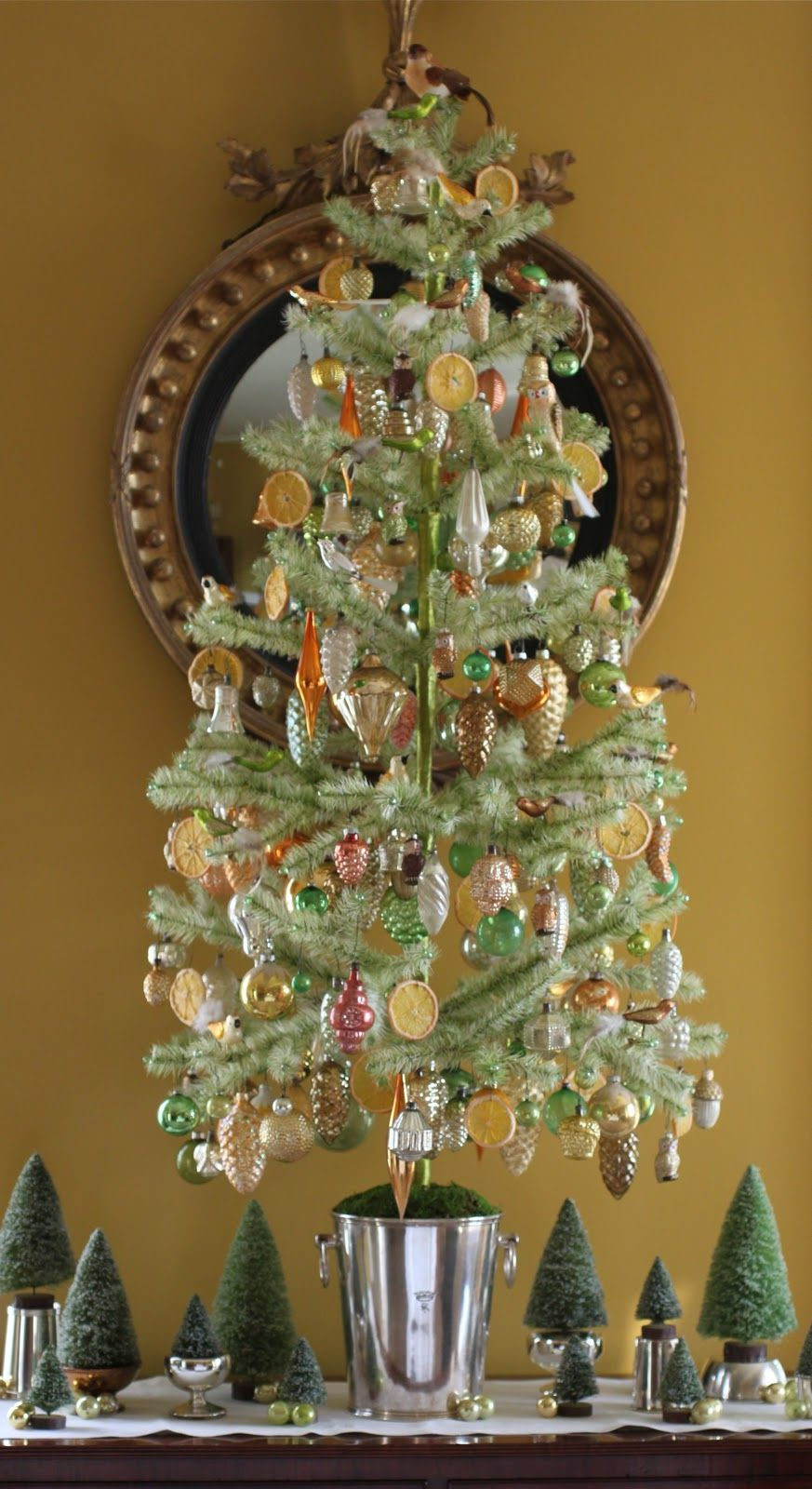 Feather tree, vintage ornaments, real slices of orange