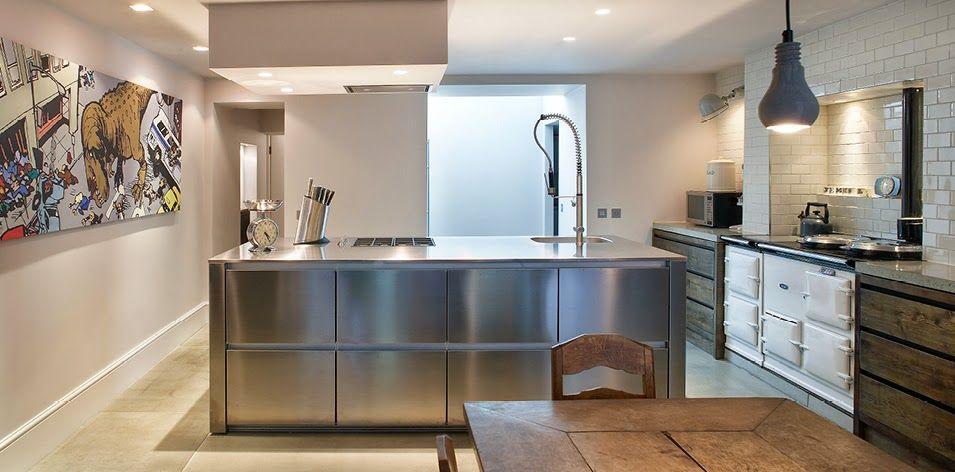 Reforma cocina con cocina de hierro fundido muebles for Cocinas de hierro fundido