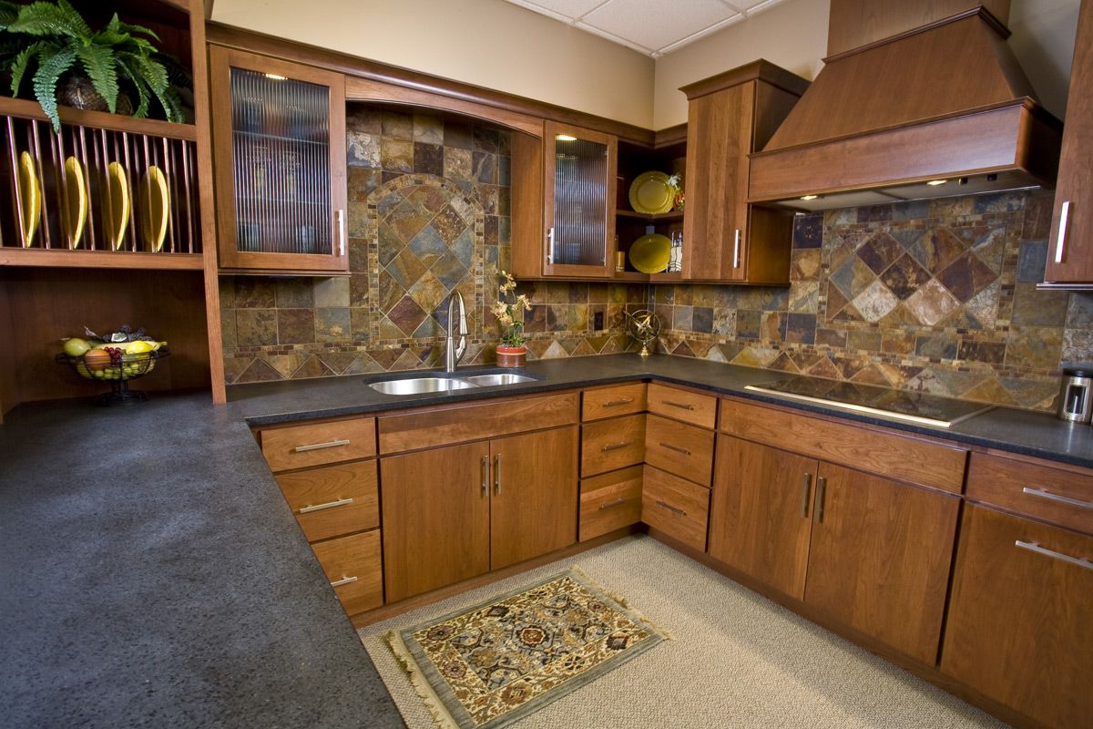 This Showplace Cherry Kitchen Features Our Merlot Stain Notice The Wall Cabinets With Reeded Gl Square Kitchen Layout Kitchen Design Beautiful Kitchen Designs