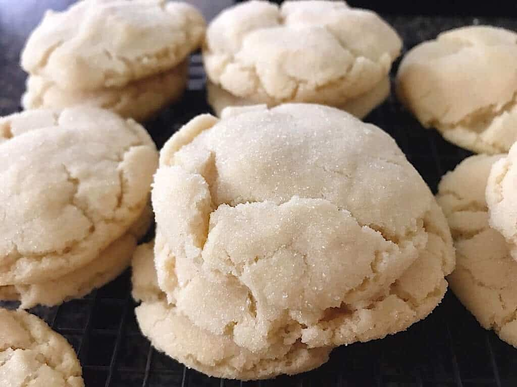Looking for the perfect recipe to make soft & chewy sugar cookies? This is it. This easy, no-chill sugar cookie recipe will quickly become your go-to and includes step by step instructions as well as a video! Don't forget the icing! #cookies #cookierecipe #dessert #sugarcookie #sugarcookies #easysugarcookies #dropsugarcookies