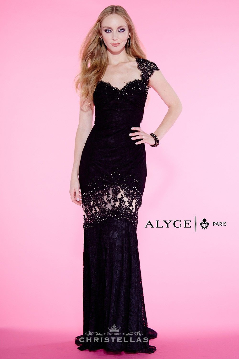Lace pops among sheer illusion details in this sultry stunner! Alyce ...