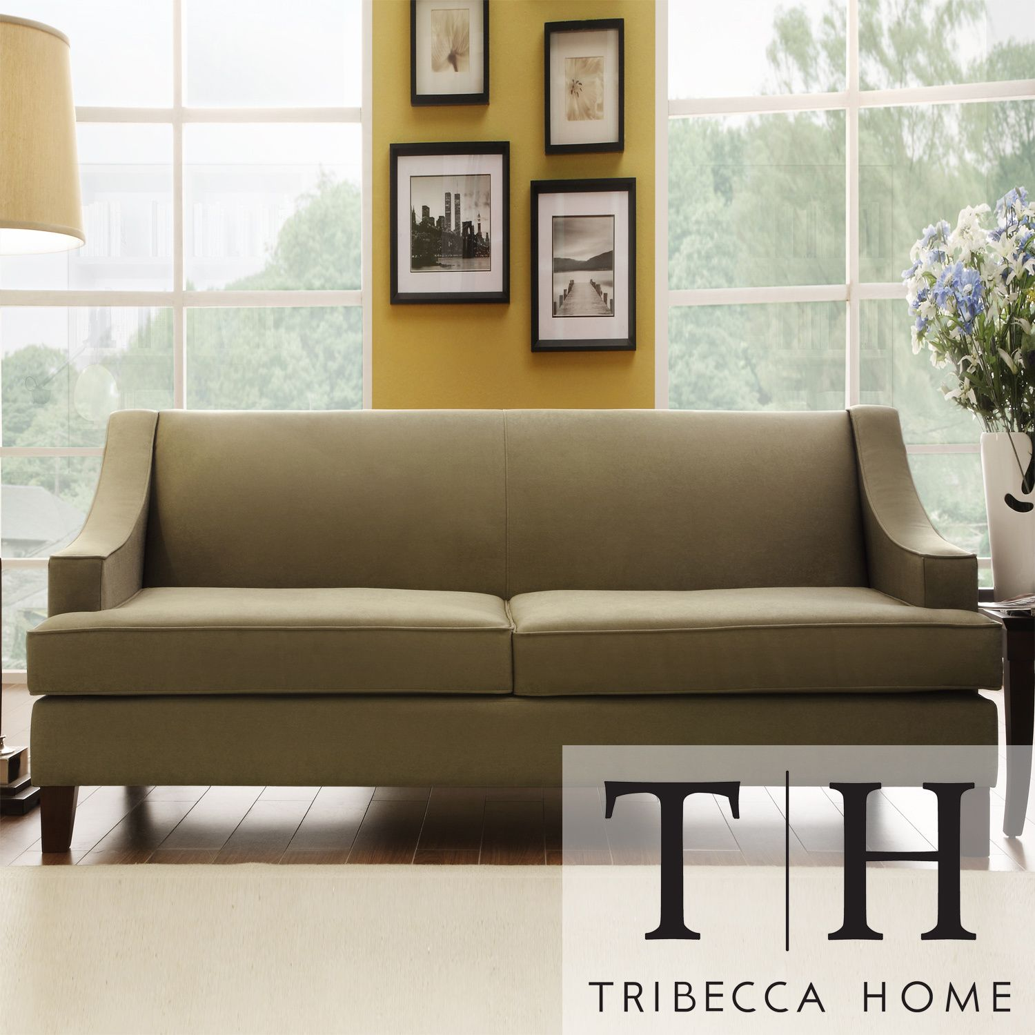 Rejuvenate your living space with this stunning microfiber sofa. The two-cushion long sofa features an elegant high back, firm cushions for added support, taupe upholstery that complements most color schemes, and wood legs with a cherry finish.