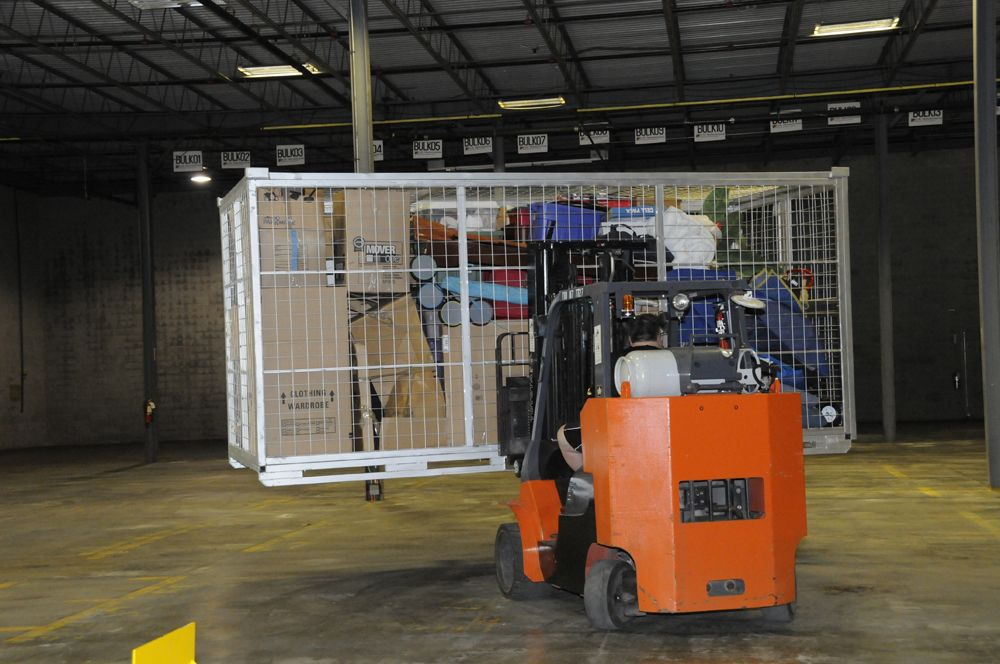 How Zippy Shell Self Storage Containers Work: Storing The Zippy Shell  Storage Containers Back In The Warehouse. A Forklift Moves The Portable  Storage ...