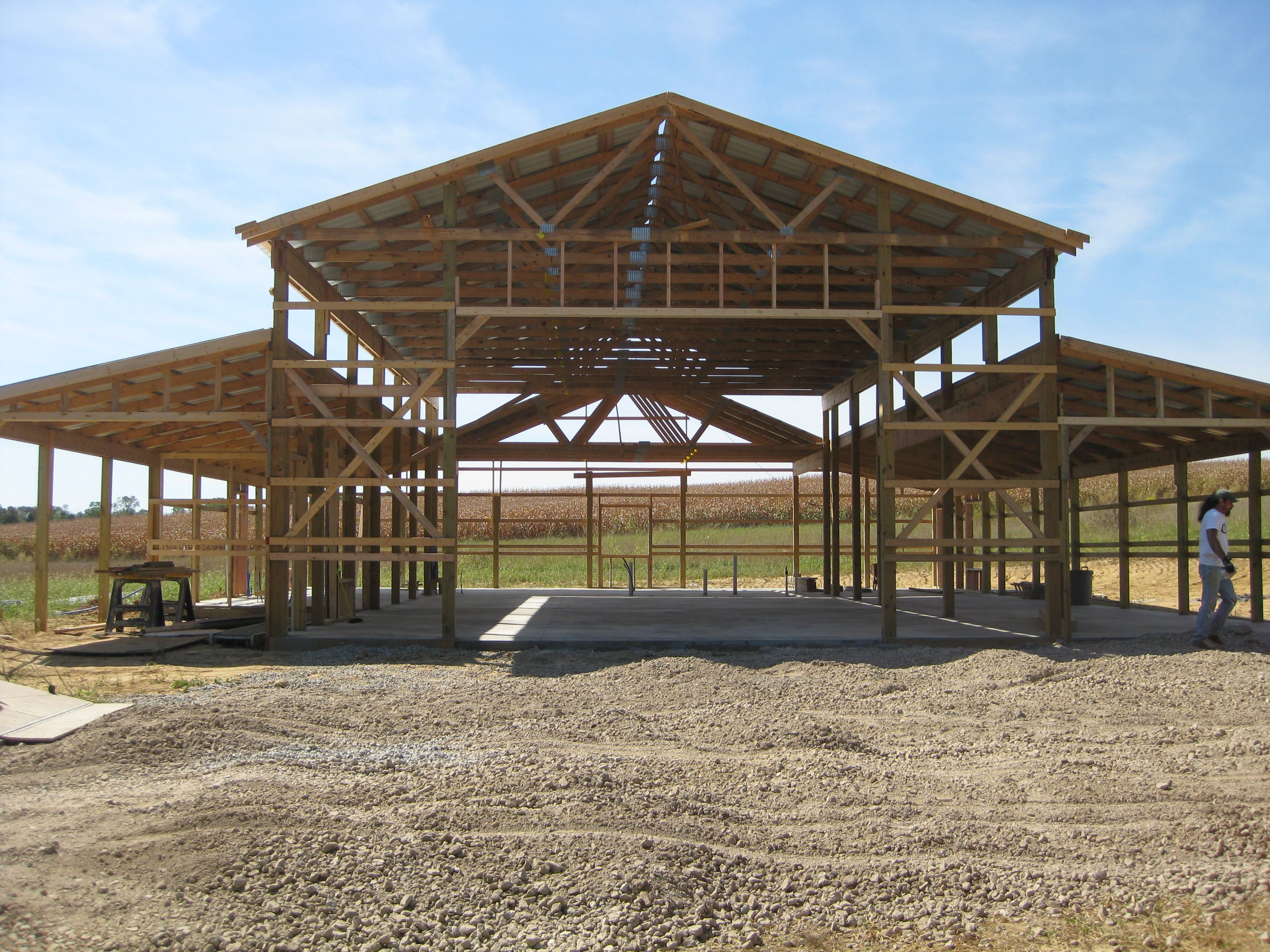Pole barn house plans with pole buildings on pinterest and for Pole barn home plans with garage