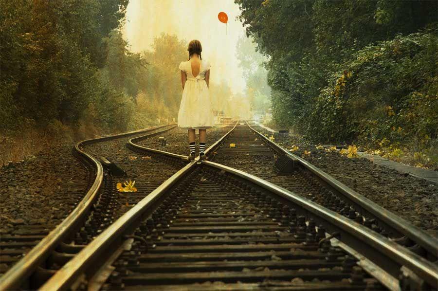 Girl on train tracks.