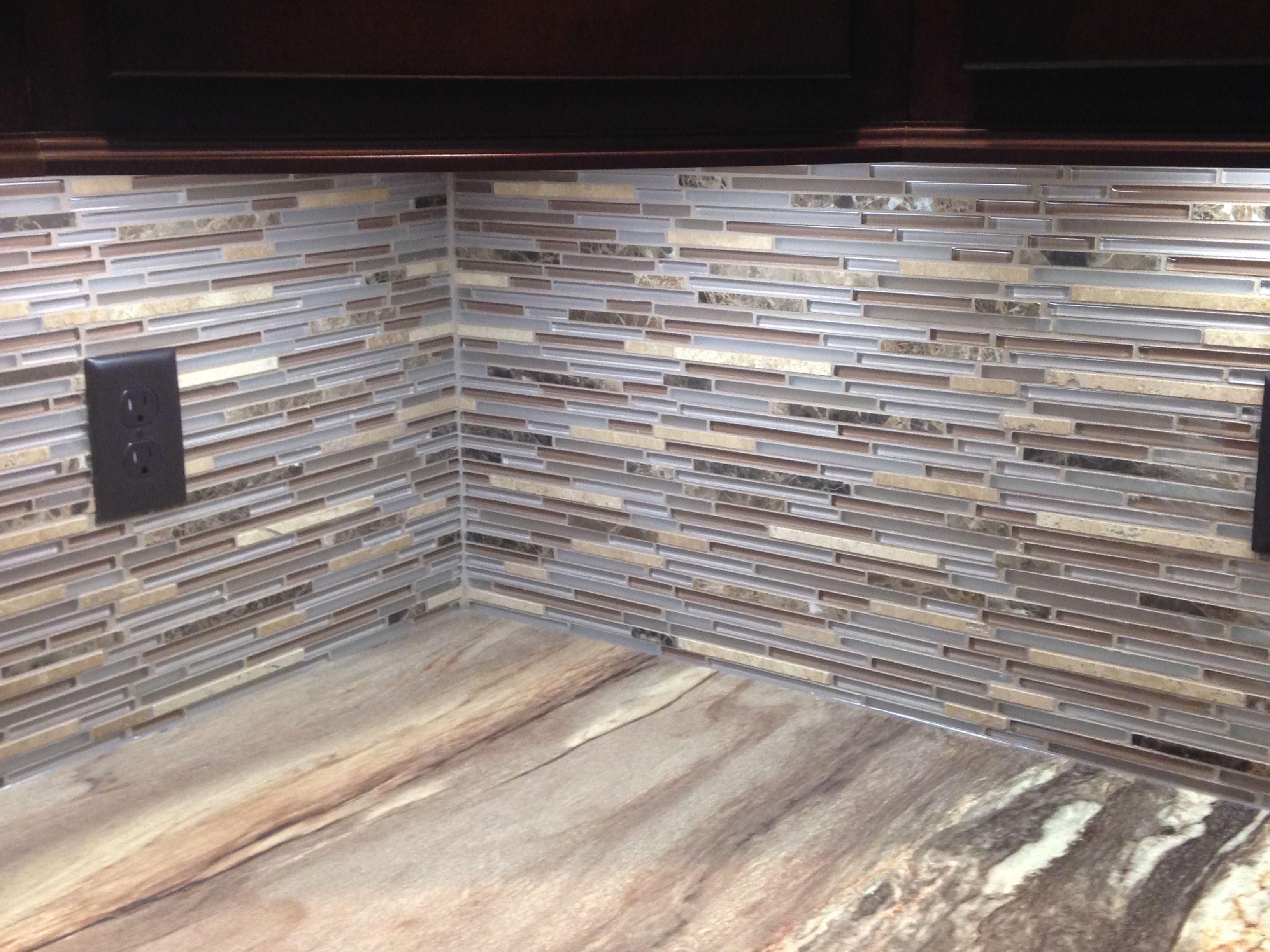 Thin tile and glass mosaic bar backsplash