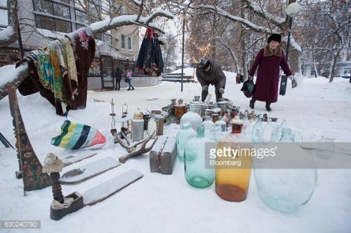 Secondhand goods sit for sale in the snow at an open air flea... #nizhniynovgorod: Secondhand goods sit for sale in the… #nizhniynovgorod