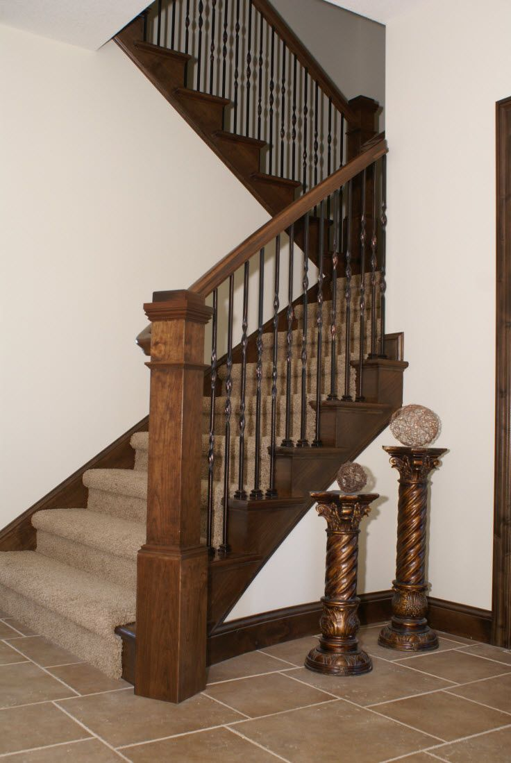 Stair Systems | Oak Staircase With Wrought Iron Balusters And An Extra Wide  Landing Step |
