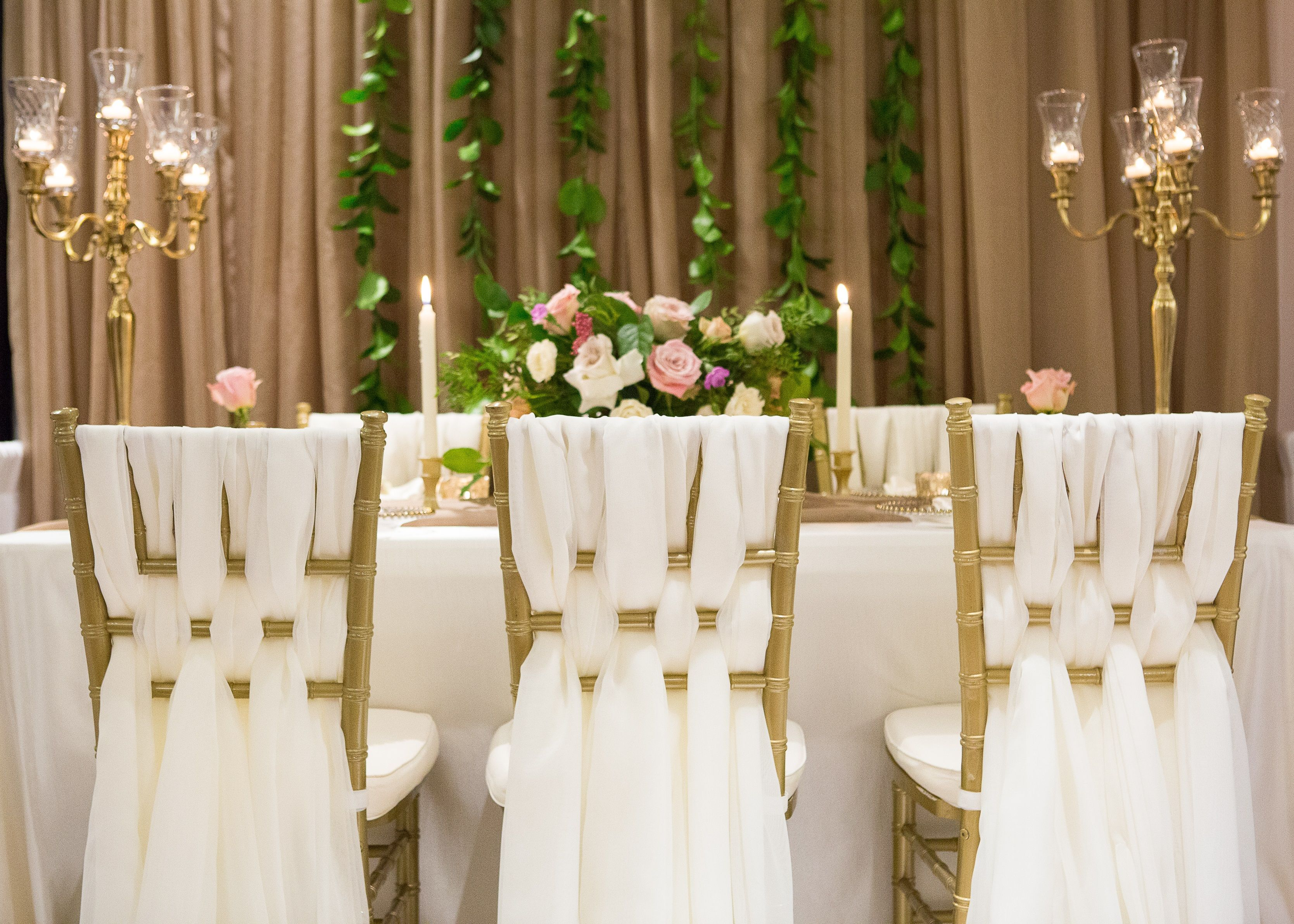 Taupe earthy toned backdrop chiavari chairs with woven fabric gold