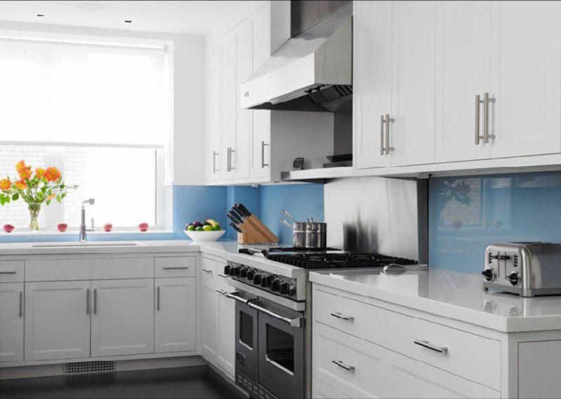 Best Backsplash for White Cabinets | kitchen with blue glass backsplash, white stone countertops, white ...