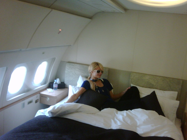 Paris Hilton On Her Bed In Plane