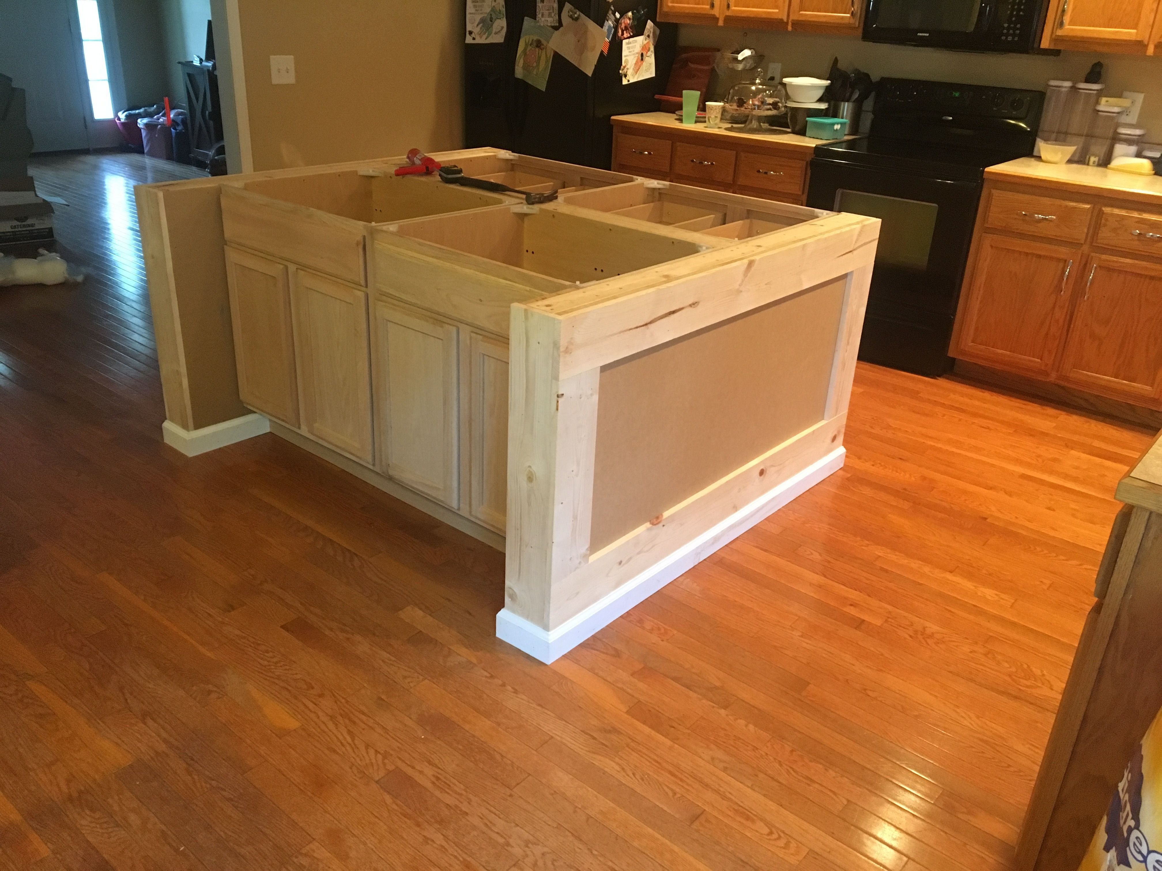 Stock Cabinets And Some Custom Framing Make For A Great Diy Island Building A Kitchen Kitchen Island Using Stock Cabinets Kitchen Island Plans