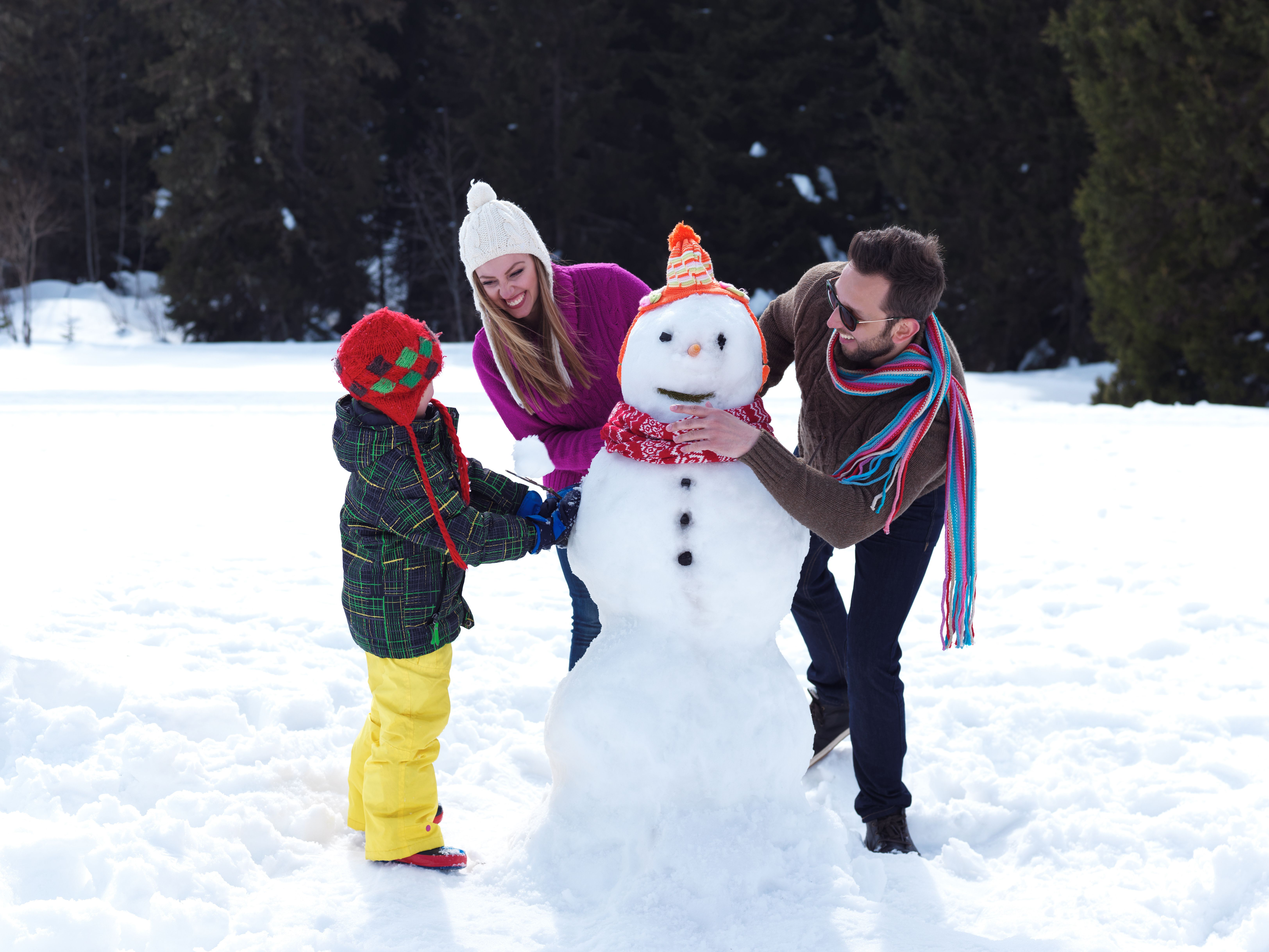 Building snowmen and sledding can both be great ways to