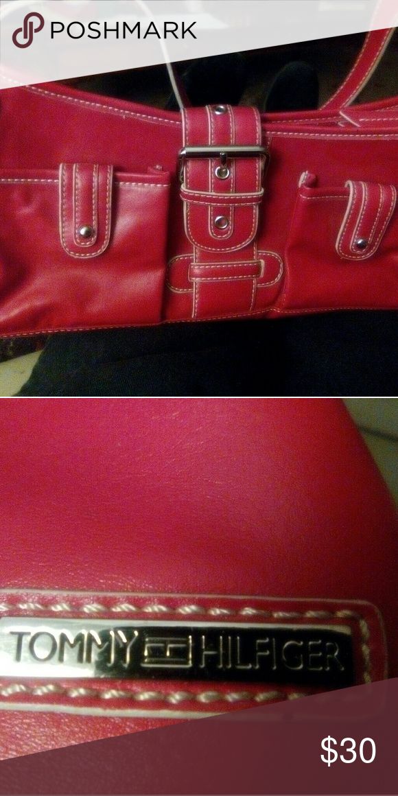 Purse Tommy Hilfiger  purse never used.  Perfect condition with cute orange lining and lots of pockets Tommy Hilfiger Bags Mini Bags