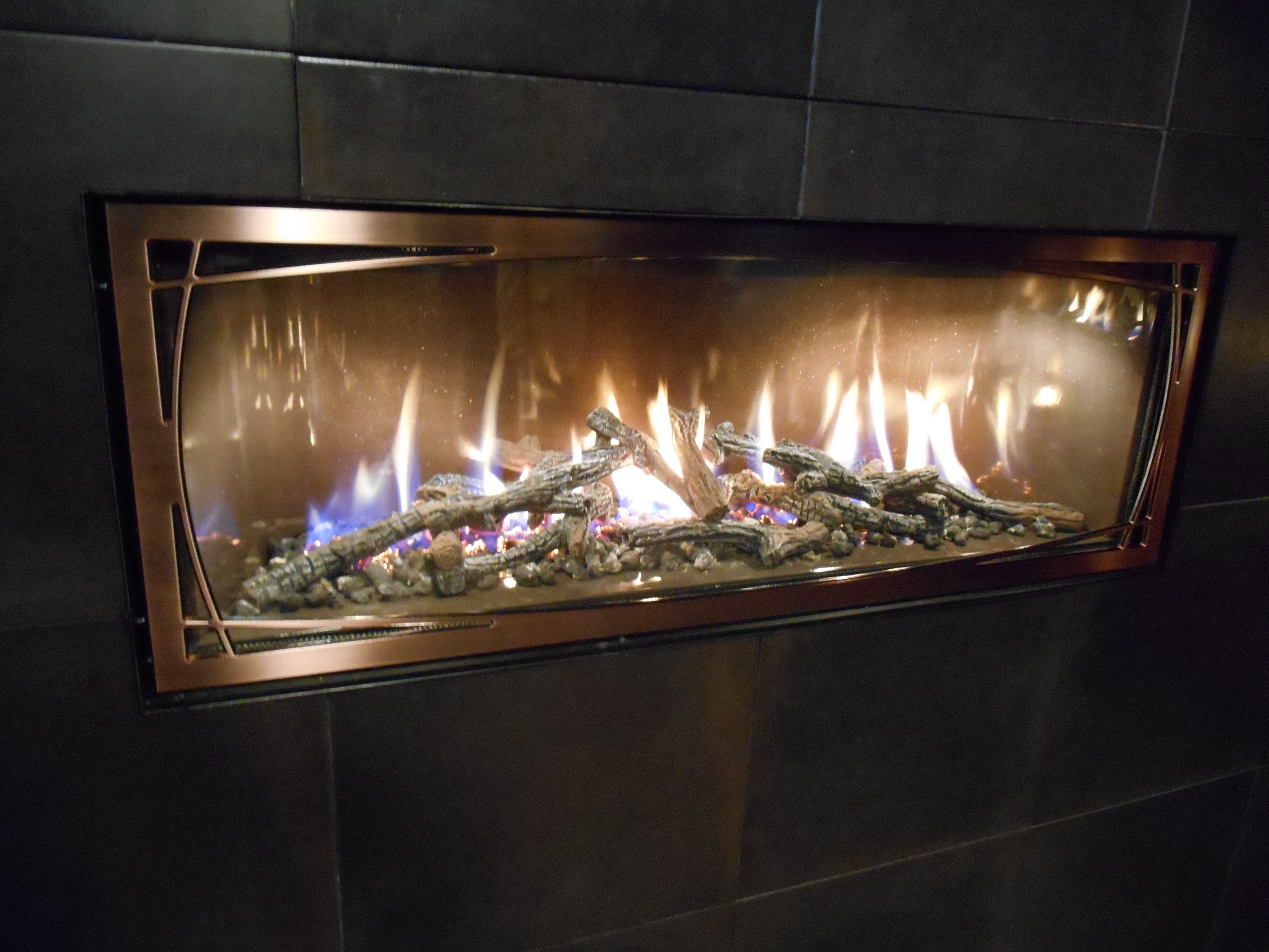 town country s linear woodburning fireplace here s something new