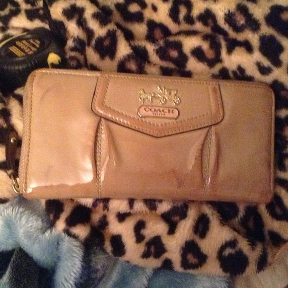 Authentic large coach wallet Coach large wallet used but still in good conditions, no holes ,rips or tears .shows some discoloration specially on the edge. Coach Bags Wallets
