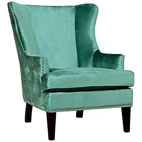 this elegant, turquoise velvet wing chair features silver nailhead