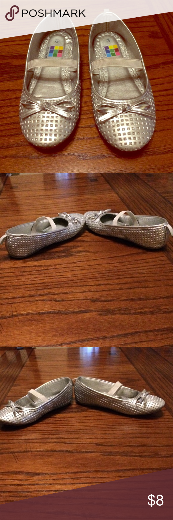 Toddler Girl's Silver Slip-on Shoes Size 10 These shoes were purchased new & have been worn a few times. They are slip-on shoes with a strap that goes across the foot. These are a toddler size 10. My 3 year old wore these. Please make offers! Shoes Dress Shoes
