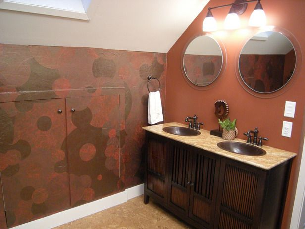 Fantastic Bathroom Makeovers: This new bathroom includes eco-friendly cork flooring and a hand-painted, wallpapered wall which was once cluttered with toiletries. An old cabinet becomes a vanity. From DIYnetwork.com