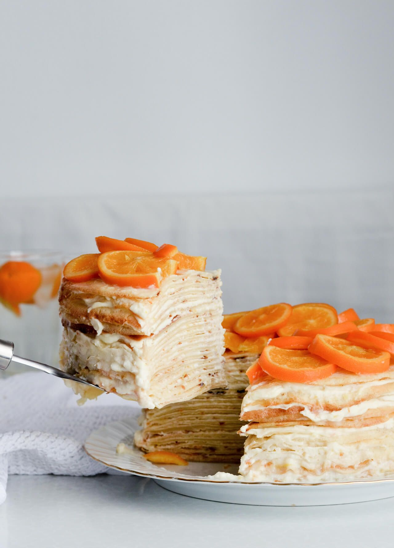 Photo of Orange ricotta crepe cake + candied orange slices