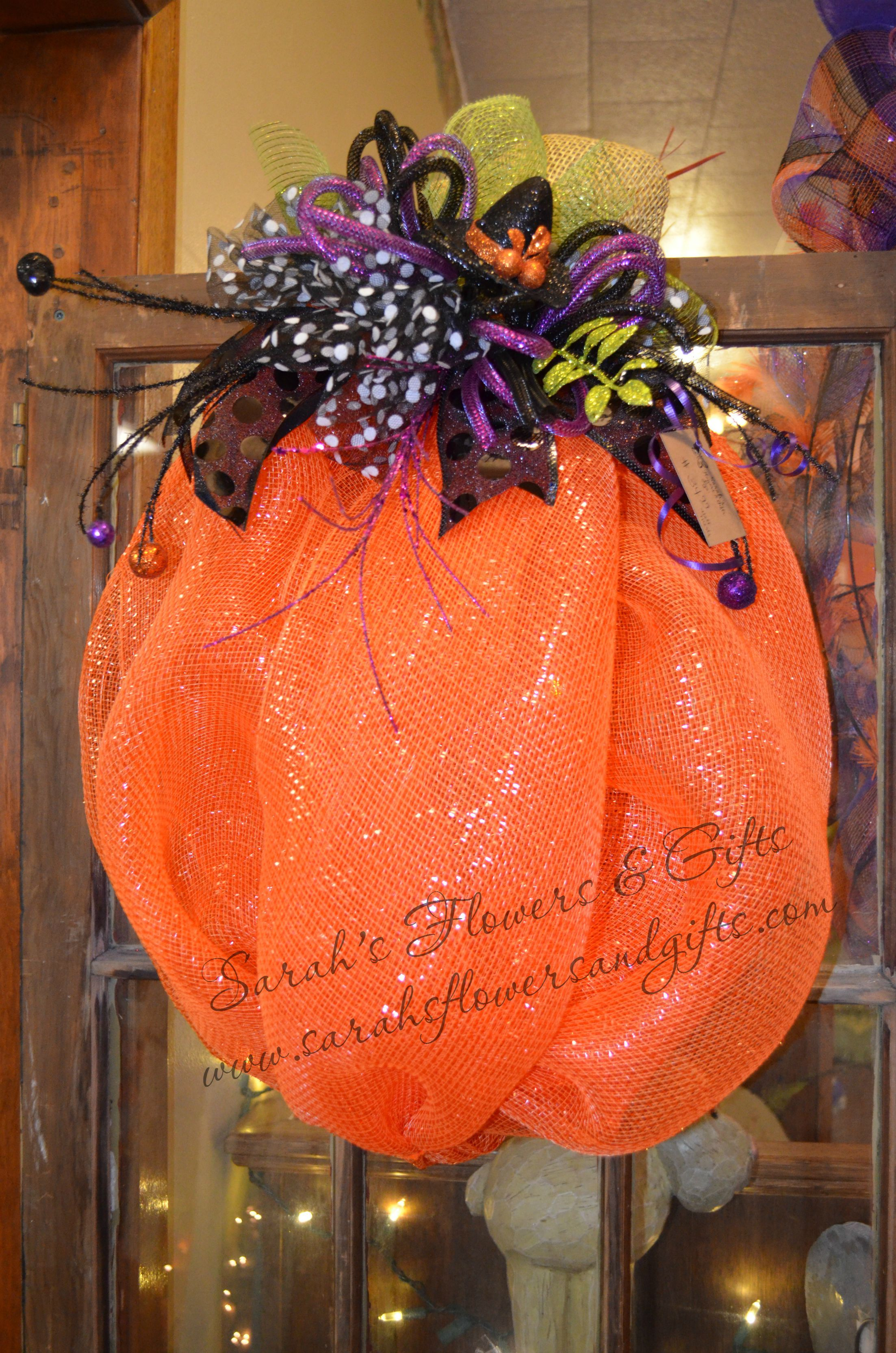 Spooktacular Pumpkin wreath for your front door or home! Handmade at Sarah's Flowers & Gifts 102 Legion Street Manchester Iowa www.sarahsflowersandgifts.com Find us on Facebook!!!