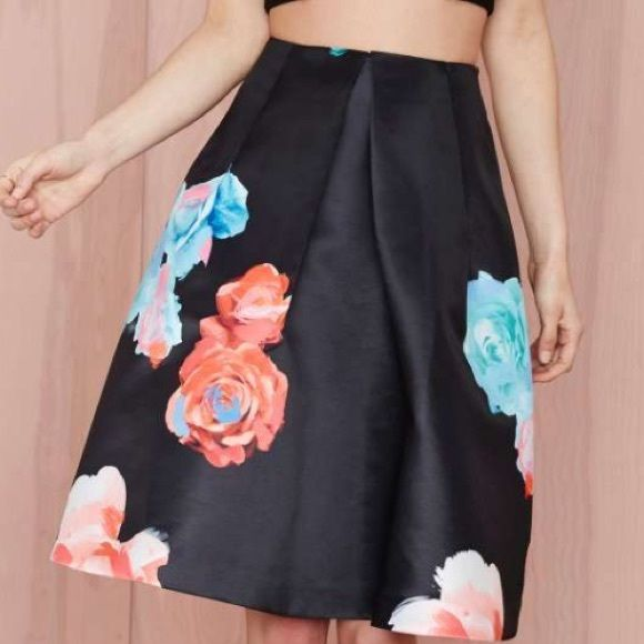 PRICE DROP!! NEW Nasty Gal Bloom and Board Skirt black taffeta skirt with graphic rose print. pleat detail and structured silhouette. blind stitching at the hem, back zip closure, unlined. Nasty Gal Skirts