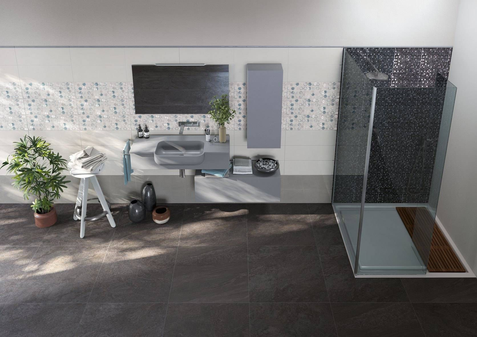 Un bagno moderno che esalta le sfumature del gres effetto pietra Genesis grazie ad un