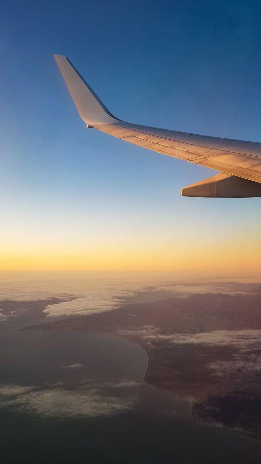 Taking off at sunrise #sunrise #flying #plane #window #planewindow #windowview #windowseat #clouds #sky #skyview #planebackground #planewallpaper #skybackground #skywallpaper #flyingbackground #flyingwallpaper #travelbackground #travelwallpaper
