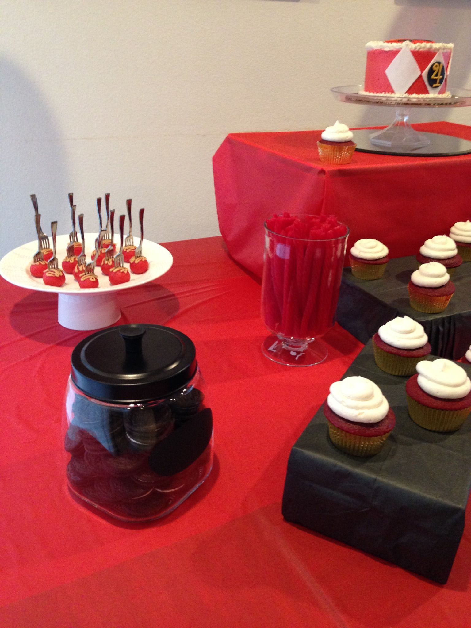 Oreo cookies and red vines as dessert table accents for a red and black color scheme.