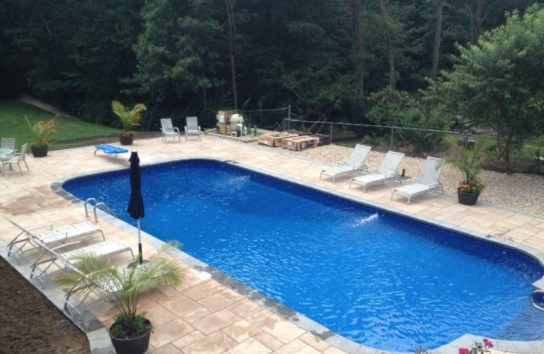 This inviting Long Island, NY pool patio was created by Fasco Paving ...