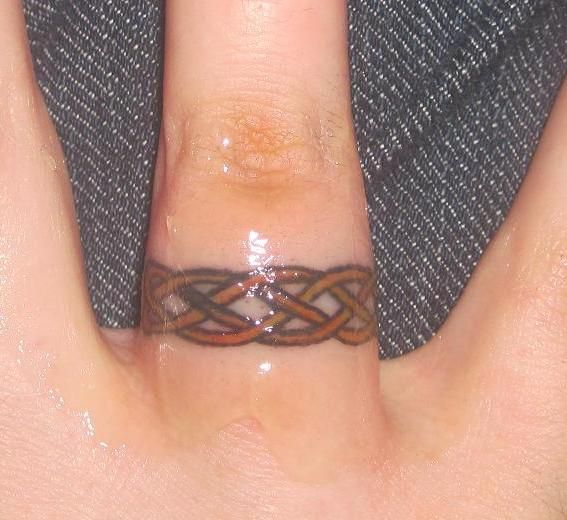 tattooed wedding bands Celtic wedding ring tattoo designs Tattoo