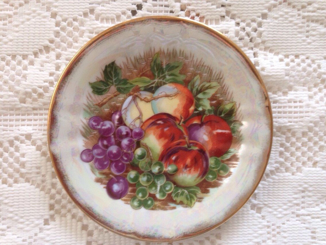 A personal favorite from my Etsy shop https://www.etsy.com/listing/227693586/lusterware-saucer-fruit-motif-vintage