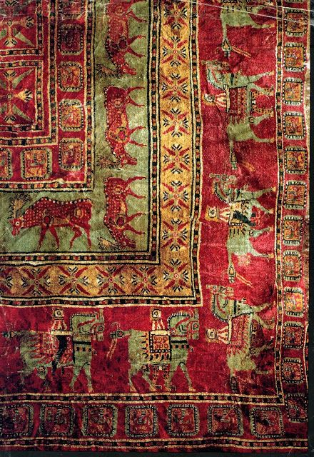 """The Pazyryk rug is the oldest surviving example of a complete rug discovered so far. It was probably produced in the 5th century BC by the nomadic Scythian people and was discovered by the Russian archaeologist Sergei Rudenko in a Scythian burial mound in the late 1940s"".    http://thetextileblog.blogspot.co.uk/2009/08/pazyryk-rug.html"