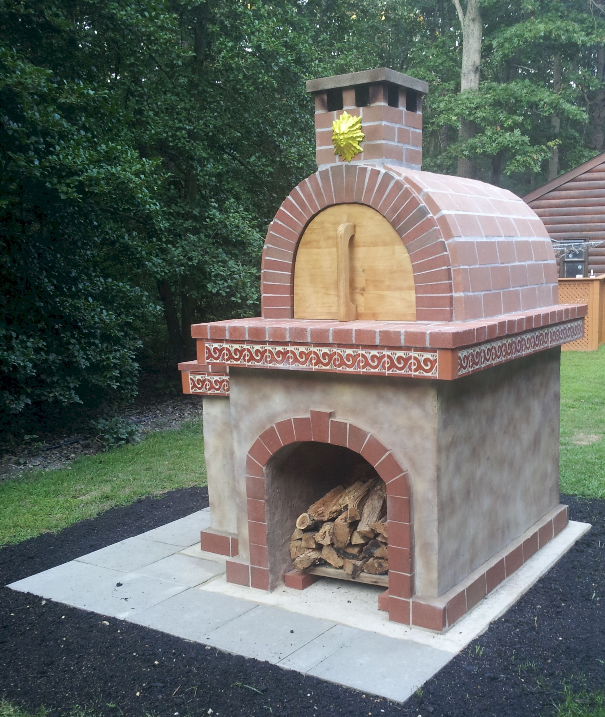 A beautiful red brick pizza oven on a pizza oven base with for Outdoor oven diy