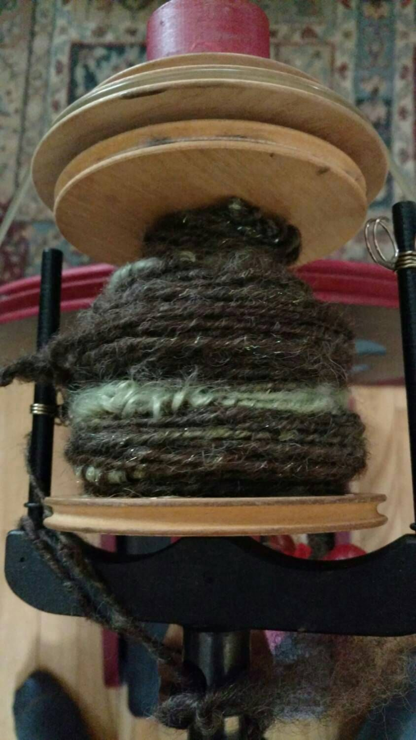 Mossy Branches is a fun chunky yarn I made with Border Leister, Wensleydale locks and pinches of gold, silver and green firestar and Angelina. I liked the batts I made so much I'm working on a second skein. Cosy, yet woodsy!