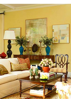 Living room with sunny yellow walls and brightly hued ...