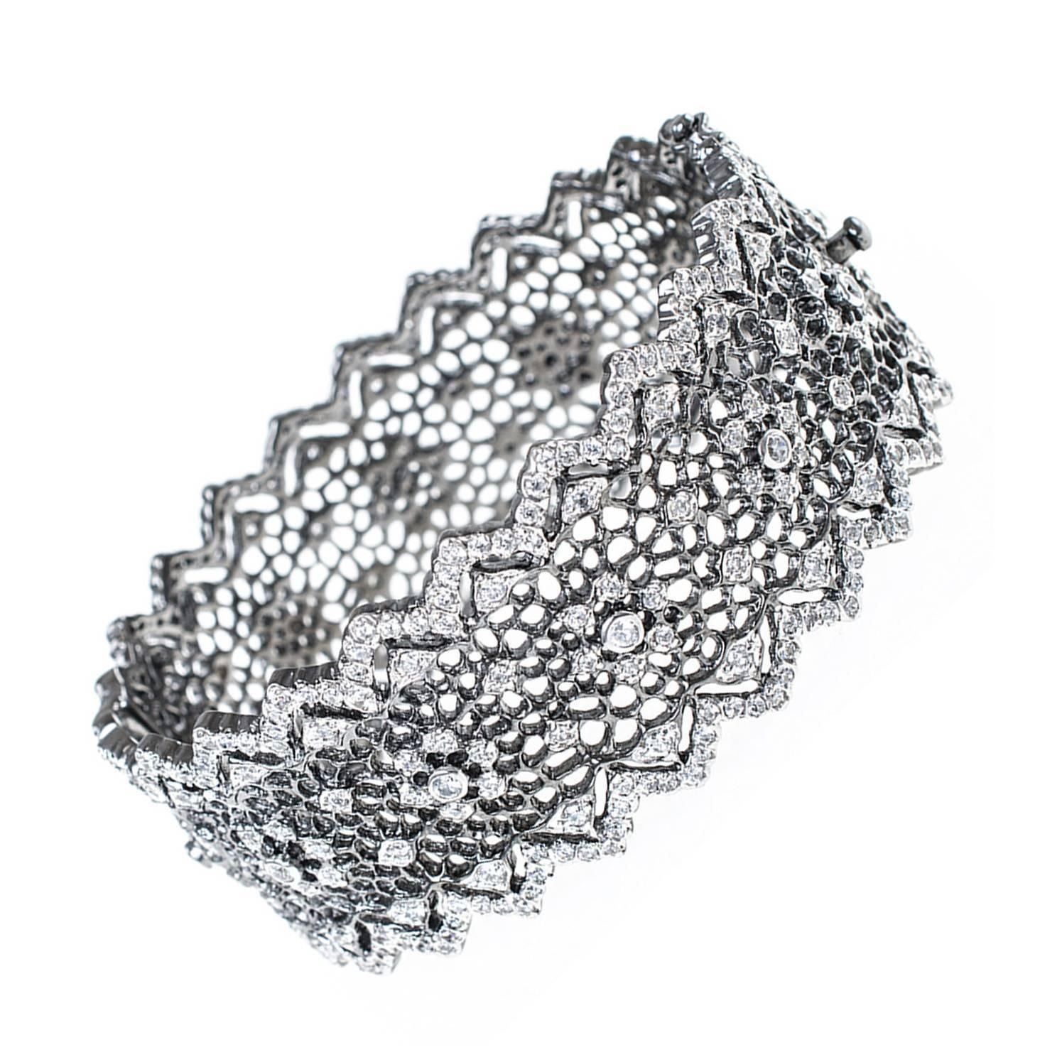 Rhodium & Cubic Zirconia Hinged Bangle | From a unique collection of vintage bangles at https://www.1stdibs.com/jewelry/bracelets/bangles/