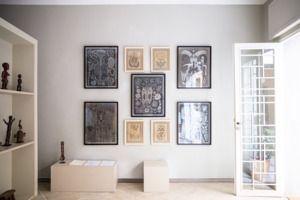 Unique wall art and plenty of natural light. | http://domino.com