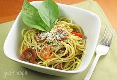 Spaghetti with Garlic Scape Pesto with Tomatoes - A quick summer pasta with ingredients you can find in your own backyard if you are lucky! #pasta #garlic